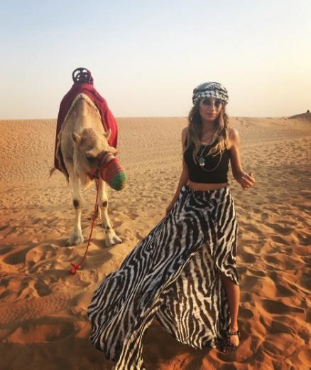 camel and girl in desert